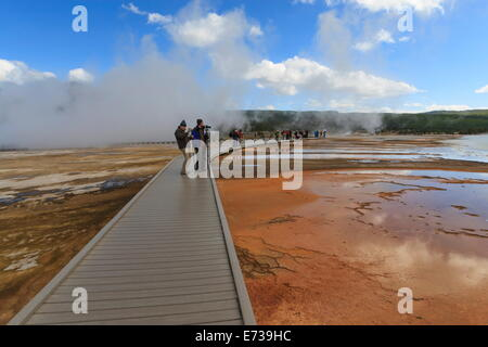 Tourist taking a photograph of Grand Prismatic Spring, Midway Geyser Basin, Yellowstone National Park, UNESCO Site, - Stock Photo