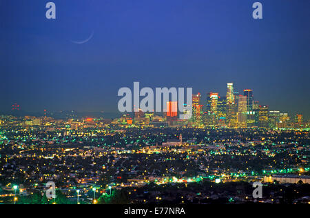 Los Angeles Civic Center and city lights at dusk from Griffith Park Observatory - Stock Photo