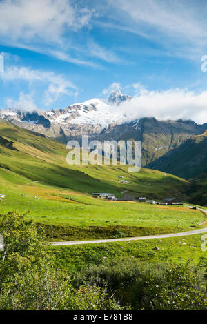 VILLE DES GLACIERS, FRANCE - AUGUST 27: Small village with Glacier Needles in the background. The region is a stage - Stock Photo