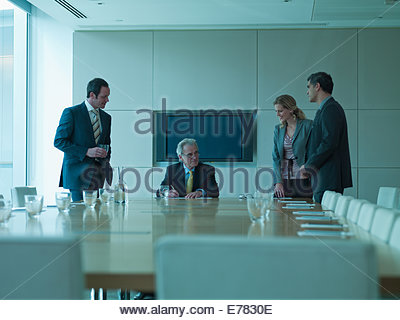 Business people watching boss sign contract - Stock Photo