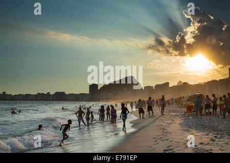 bathers and people relaxing on the Copacabana Beach, Rio de Janeiro, Brazil - Stock Photo