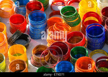 Colourful bangles on sale at a market stall - Stock Photo