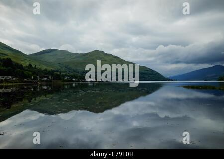 Loch reflection - Hills and clouds reflected in a Scottish loch - Stock Photo