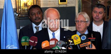 Damascus, Syria. 11th Sep, 2014. UN envoy to Syria, Staffan De Mistura (front) speaks to reporters at Sheraton hotel - Stock Photo