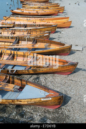 Group of rowing boats on the shore of Derwentwater at Keswick, Allerdale, Cumbria, England, UK - Stock Photo