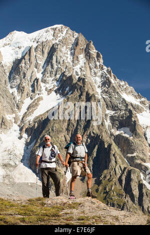 Walkers doing the Tour du Mont Blanc on Mont de la Saxe above courmayeur in Italy, looking across to the Dent Du - Stock Photo