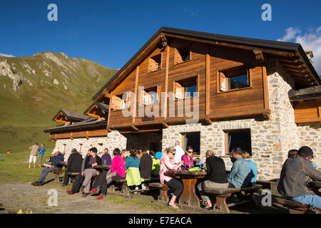 Walkers doing the Tour Du Mont Blanc outside the Bonatti Hut opposite the Grande Jorasses in the Italian Alps. - Stock Photo