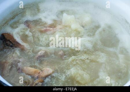 Pieces of Meat Cooking in the Boiling Water - Stock Photo