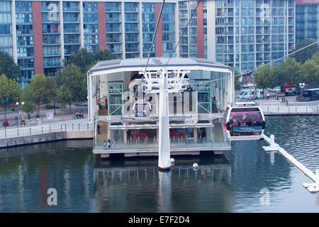 Gondolas of the Emirates Air Line cable car aarriving at Royal Docks terminal, East London - Stock Photo