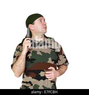 Man in camouflage with knife in hand. Isolated on white background - Stock Photo