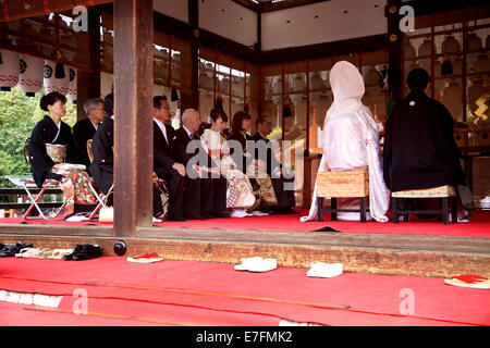 Traditional japanese weeding ceremony in temple, pagoda. Kyoto, Japan, Asia - Stock Photo