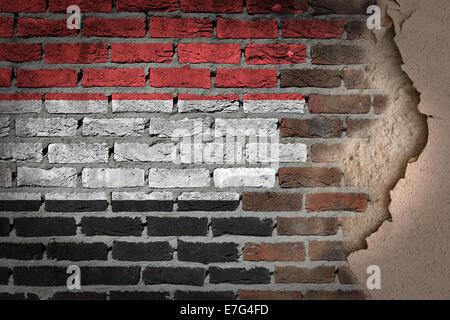 Dark brick wall texture with plaster - flag painted on wall - Yemen - Stock Photo