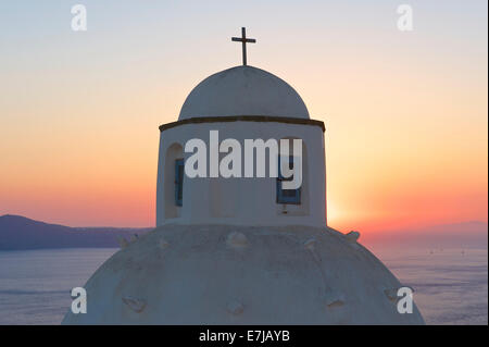 Church dome at sunset, Thira, Santorini, Cyclades, Greece - Stock Photo