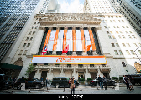 New York, USA. 19th Sep, 2014. Visitors outside the New York Stock Exchange decorated for the first day of trading - Stock Photo