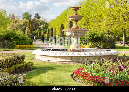 Fountain, trees and flowers in Avenue Gardens at Regents Park, London, England, UK - Stock Photo