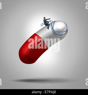 Medication control health care concept as a patient riding and piloting a giant capsule pill using a harness as - Stock Photo