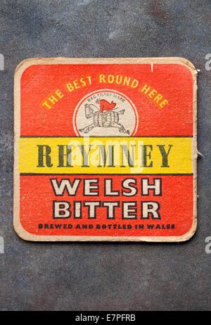 Vintage Welsh Brewery Beermat advertising local beer 'Rhymney Welsh Bitter' Brewed and Bottled in Wales - Stock Photo