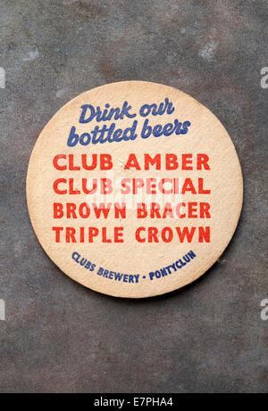 Vintage Welsh Brewery Beermat advertising local beers 'Club Amber' 'Club Special' 'Brown Bracer' 'Triple Crown' - Stock Photo