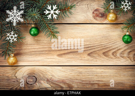 Christmas background with spruce tree, snowflakes and christmas balls on table. Copy space. Top view - Stock Photo