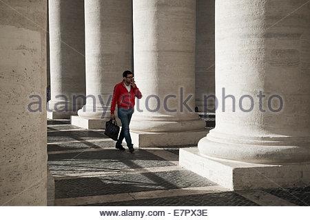Smoking Man Walking Through Piazza San Pietro in Citta del Vaticano, Roma, Italia - Stock Photo