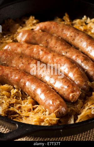 Roasted Beer Bratwurst with Saurkraut in a Pan - Stock Photo