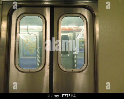Coney Island Q train sits at station in Manhattan, NYC, waiting for passengers - Stock Photo