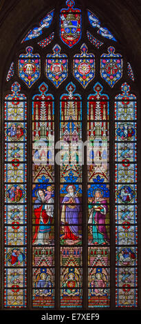 BRUGES, BELGIUM - JUNE 12, 2014: The Presentation in the Temple as central scene on the windowpane in st. Jacobs - Stock Photo
