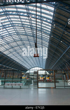London St Pancras railway station - an interior view of vast, historic iron & glass Barlow train shed with trains - Stock Photo