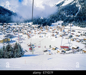 Chairlift and Morgins village ski resort Swiss Alps Valais Switzerland - Stock Photo