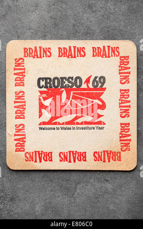 Vintage Welsh Brewery Beermat advertising local 'Brains' beer in 1969 to commemorate the Investiture of Prince Charles - Stock Photo