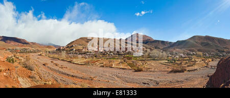 Horizontal panoramic (2 picture stitch) landscape of a traditional Berber mudbrick village in the High Atlas Mountains. - Stock Photo