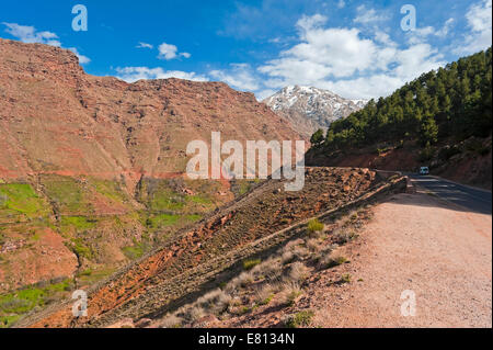 Horizontal view of the red sandstones cliffs in the High Atlas Mountain range in Morocco. - Stock Photo