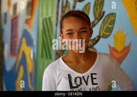 Smiling teenage girl, Ponta da Serra, Crato, State of Ceará, Brazil - Stock Photo