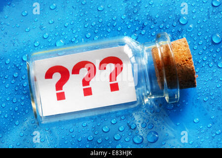 Question mark message in a bottle - Stock Photo