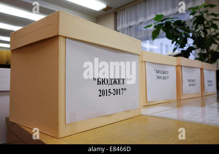 Moscow, Russia. 30th Sep, 2014. Boxes of documents for draft federal budgets for 2015, 2016, and 2017 which are - Stock Photo