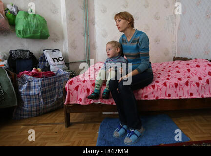 Moscow, Russia. 30th Sep, 2014. Refugees from east Ukraine at a temporary accommodation centre at Lastochka Boarding - Stock Photo