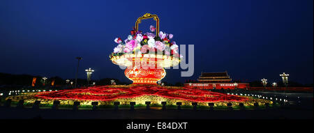 Beijing, China. 30th Sep, 2014. A huge parterre, which is set up to celebrate China's National Day on Oct. 1, is - Stock Photo