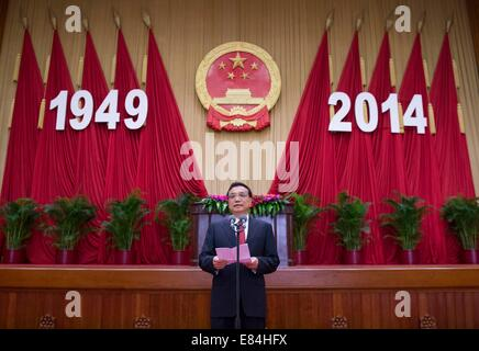 Beijing, China. 30th Sep, 2014. Chinese Premier Li Keqiang presides over the reception held by the State Council - Stock Photo