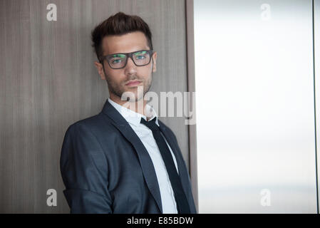 Young man waiting for elevator - Stock Photo