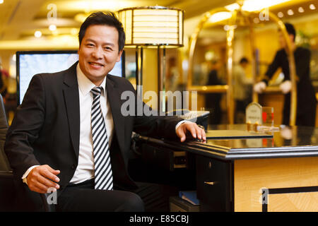Portrait of hotel service staff - Stock Photo