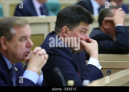 Moscow, Russia. 1st October, 2014.  Senator Mikhail Margelov (C) looks on during a Federation Council plenary session. - Stock Photo