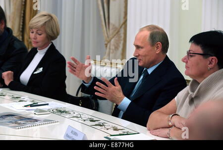Moscow, Russia. 1st October, 2014. Russia's president Vladimir Putin (C) meets with the directors of regional history - Stock Photo
