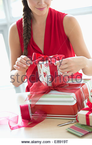 Woman wrapping Christmas gifts - Stock Photo