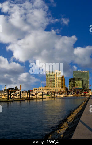 The Baltimore Inner Harbor during a beautiful cloud filled sky in the late afternoon. - Stock Photo