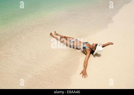 woman lying on the beach, Koh Lipe, Thailand - Stock Photo