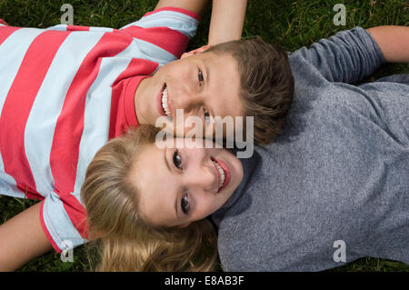 Portrait of teenage couple relaxing, smiling - Stock Photo