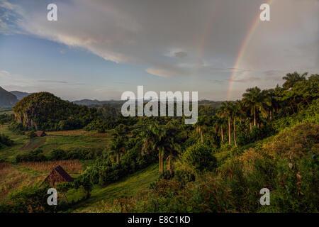 rainbow in the evening landscape of Vinales, Pinar del Rio province, Cuba - Stock Photo