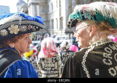 Trafalgar Square, London, UK. 5th October 2014. Pearly Kings & Queens on the steps of the church of St Martins in - Stock Photo