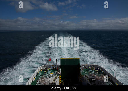 Caledonian Macbride (CalMac) car ferry Finlaggan en route from Kennacraig to Islay Port Askaig - Stock Photo