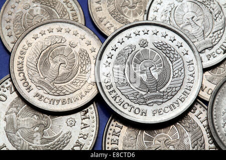 Coins of Uzbekistan. State emblem of Uzbekistan depicted in the Uzbekistani som coins. - Stock Photo